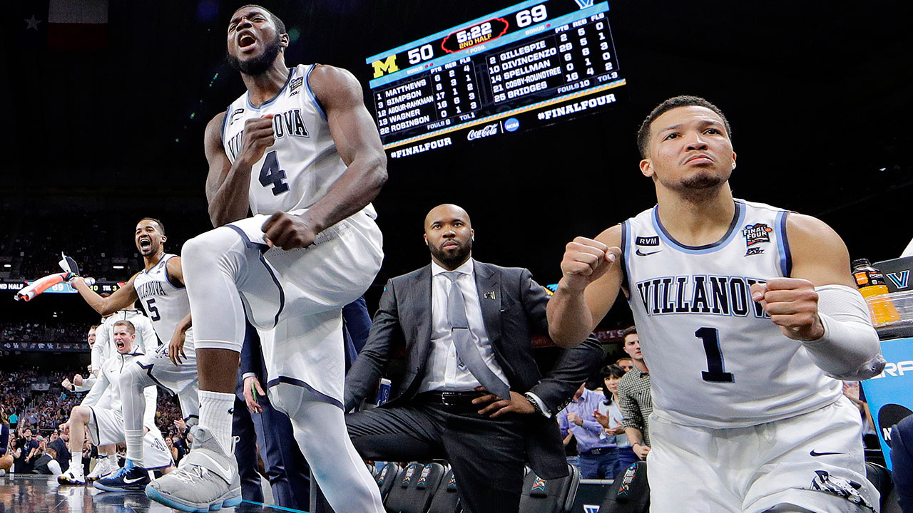 Villanova's Jalen Brunson (1) and Eric Paschall (4) react during the championship game of the NCAA college basketball tournament against Michigan, in San Antonio.