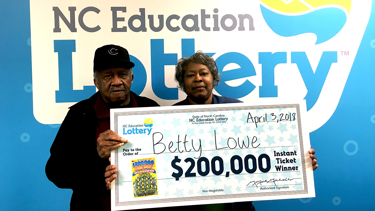 Betty Lowe with her winnings.