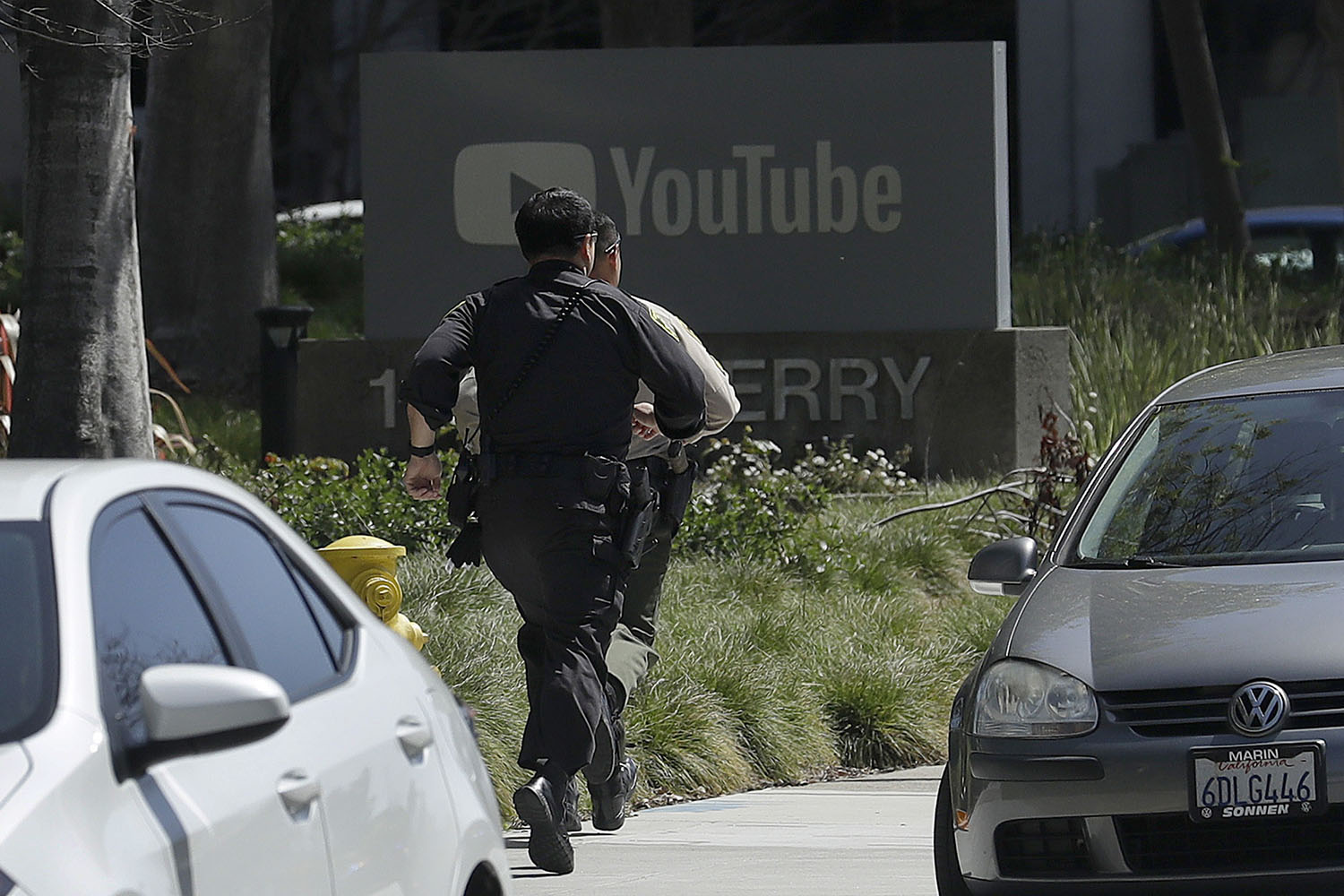 <div class='meta'><div class='origin-logo' data-origin='none'></div><span class='caption-text' data-credit='Jeff Chiu/AP Photo'>Officers run toward a YouTube office in San Bruno, Calif., Tuesday, April 3, 2018. Police say they're responding to an active shooter at YouTube headquarters.</span></div>