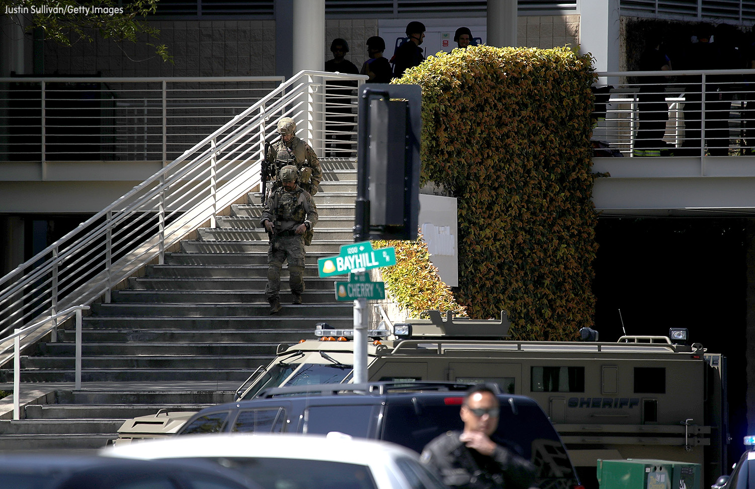 <div class='meta'><div class='origin-logo' data-origin='none'></div><span class='caption-text' data-credit='Justin Sullivan/Getty Images'>Police in tactical gear walk outside of the YouTube headquarters on April 3, 2018 in San Bruno, California.</span></div>