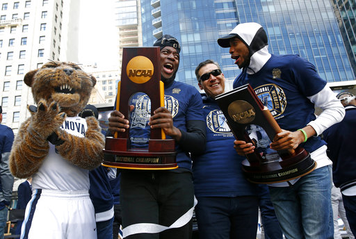 "<div class=""meta image-caption""><div class=""origin-logo origin-image ap""><span>AP</span></div><span class=""caption-text"">Eric Paschall, Jay Wright, Mikal Bridges celebrate during a rally following a parade for the team's NCAA college basketball championship, Thursday, April 5, 2018, in Philadelphia. ((AP Photo/Patrick Semansky))</span></div>"