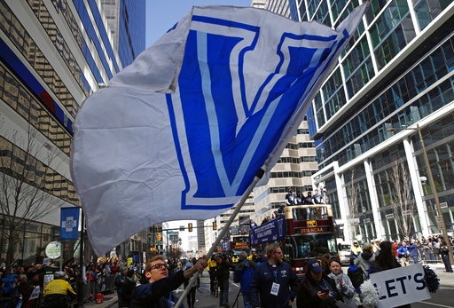 "<div class=""meta image-caption""><div class=""origin-logo origin-image ap""><span>AP</span></div><span class=""caption-text"">A student waves a Villanova flag in front of buses carrying members of the Villanova basketball team, Thursday, April 5, 2018, in Philadelphia.(AP ((AP Photo/Patrick Semansky))</span></div>"