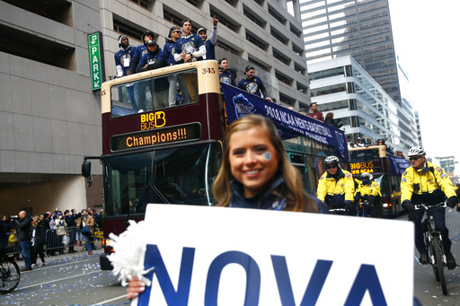 "<div class=""meta image-caption""><div class=""origin-logo origin-image ap""><span>AP</span></div><span class=""caption-text"">Members of the Villanova basketball team wave to fans from atop a bus during a parade celebrating their NCAA college basketball championship, Thursday, April 5, 2018. ((AP Photo/Patrick Semansky))</span></div>"
