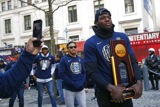 "<div class=""meta image-caption""><div class=""origin-logo origin-image ap""><span>AP</span></div><span class=""caption-text"">Villanova forward Eric Paschall enters a rally following a parade celebrating the team's NCAA college basketball championship, Thursday, April 5, 2018, in Philadelphia. ((AP Photo/Patrick Semansky))</span></div>"