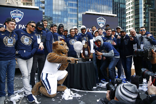 "<div class=""meta image-caption""><div class=""origin-logo origin-image ap""><span>AP</span></div><span class=""caption-text"">Members of the Villanova basketball team pose during a rally following a parade celebrating their NCAA college basketball championship, Thursday, April 5, 2018, in Philadelphia. ((AP Photo/Patrick Semansky))</span></div>"