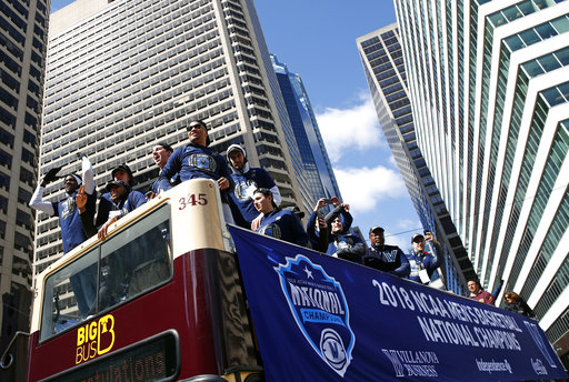 "<div class=""meta image-caption""><div class=""origin-logo origin-image ap""><span>AP</span></div><span class=""caption-text"">Members of the Villanova basketball team wave to fans during a parade celebrating their NCAA college basketball championship, Thursday, April 5, 2018, in Philadelphia. ((AP Photo/Patrick Semansky))</span></div>"