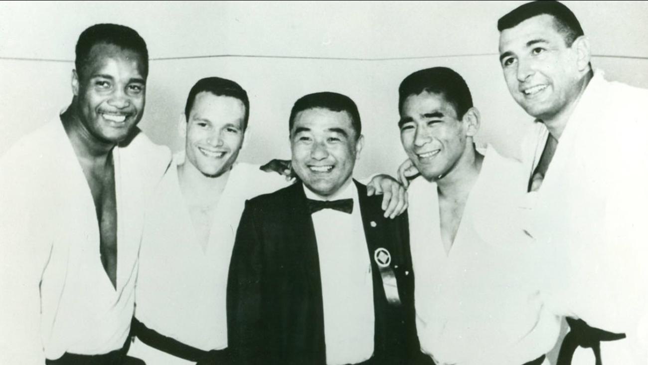 This image shows Yoshihiro Uchida and the 1964 Olympic Judo team in Tokyo.