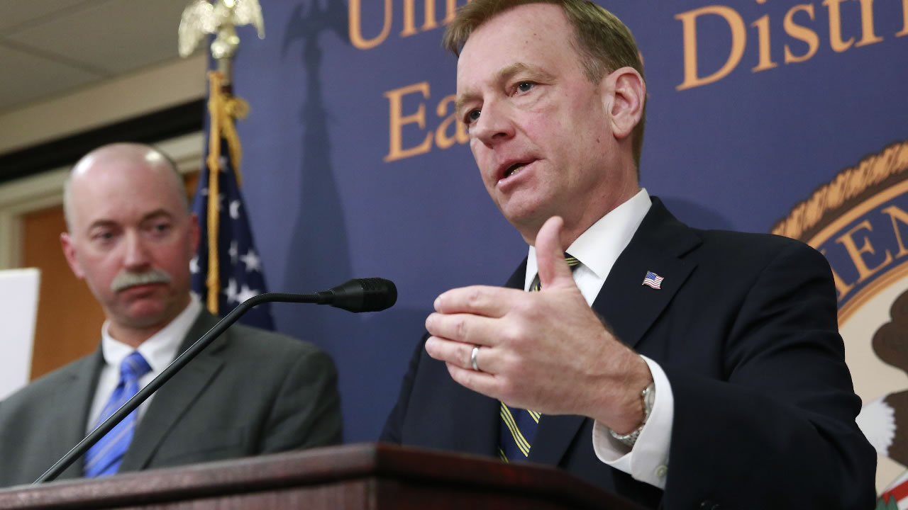McGregor Scott, right, United States Attorney For the Eastern District of California, is seen during a news conference, Wednesday, April 4, 2018, in Sacramento, Calif. (AP Photo)