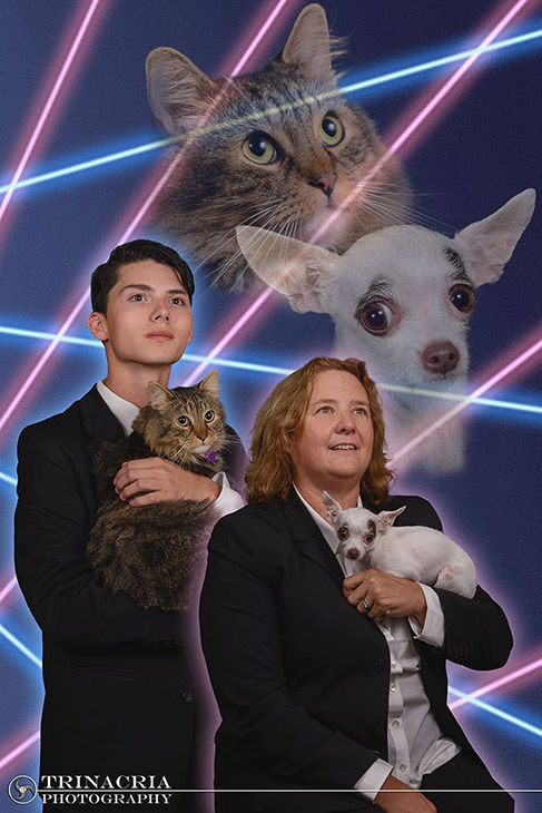 """<div class=""""meta image-caption""""><div class=""""origin-logo origin-image """"><span></span></div><span class=""""caption-text"""">Draven Rodriquez posed for a retro-style photo shoot with his cat, Mr. Bigglesworth as well as Principal Diane Wilkinson and her Chihuahua, Vivian. (Vincent Giordano/Trinacria Photography)</span></div>"""
