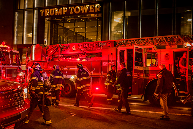 <div class='meta'><div class='origin-logo' data-origin='AP'></div><span class='caption-text' data-credit=''>Firefighters work in front of Trump Tower in New York on Saturday, April 7, 2018 after battling a fire. (AP Photo/Andres Kudacki)</span></div>