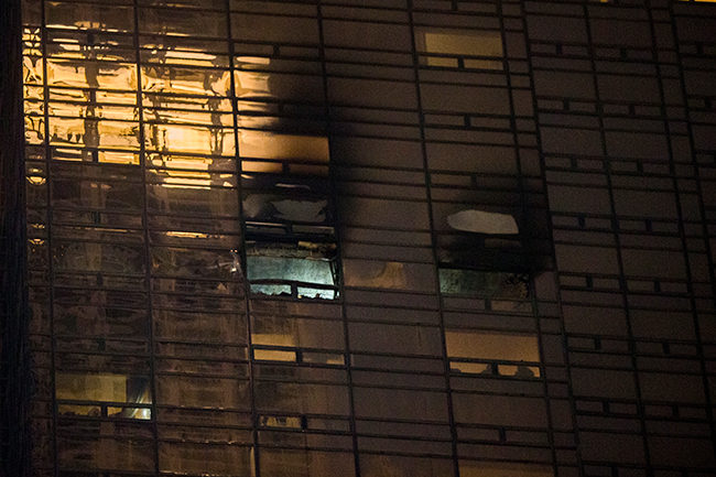 <div class='meta'><div class='origin-logo' data-origin='AP'></div><span class='caption-text' data-credit=''>Fire damage is seen on a side of Trump Tower in New York, Saturday, April 7, 2018. (AP Photo/Andres Kudacki)</span></div>
