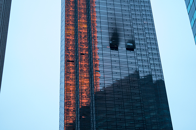 "<div class=""meta image-caption""><div class=""origin-logo origin-image ap""><span>AP</span></div><span class=""caption-text"">Fire damage is seen on a side of Trump Tower in New York on Saturday, April 7, 2018. (AP Photo/Craig Ruttle)</span></div>"