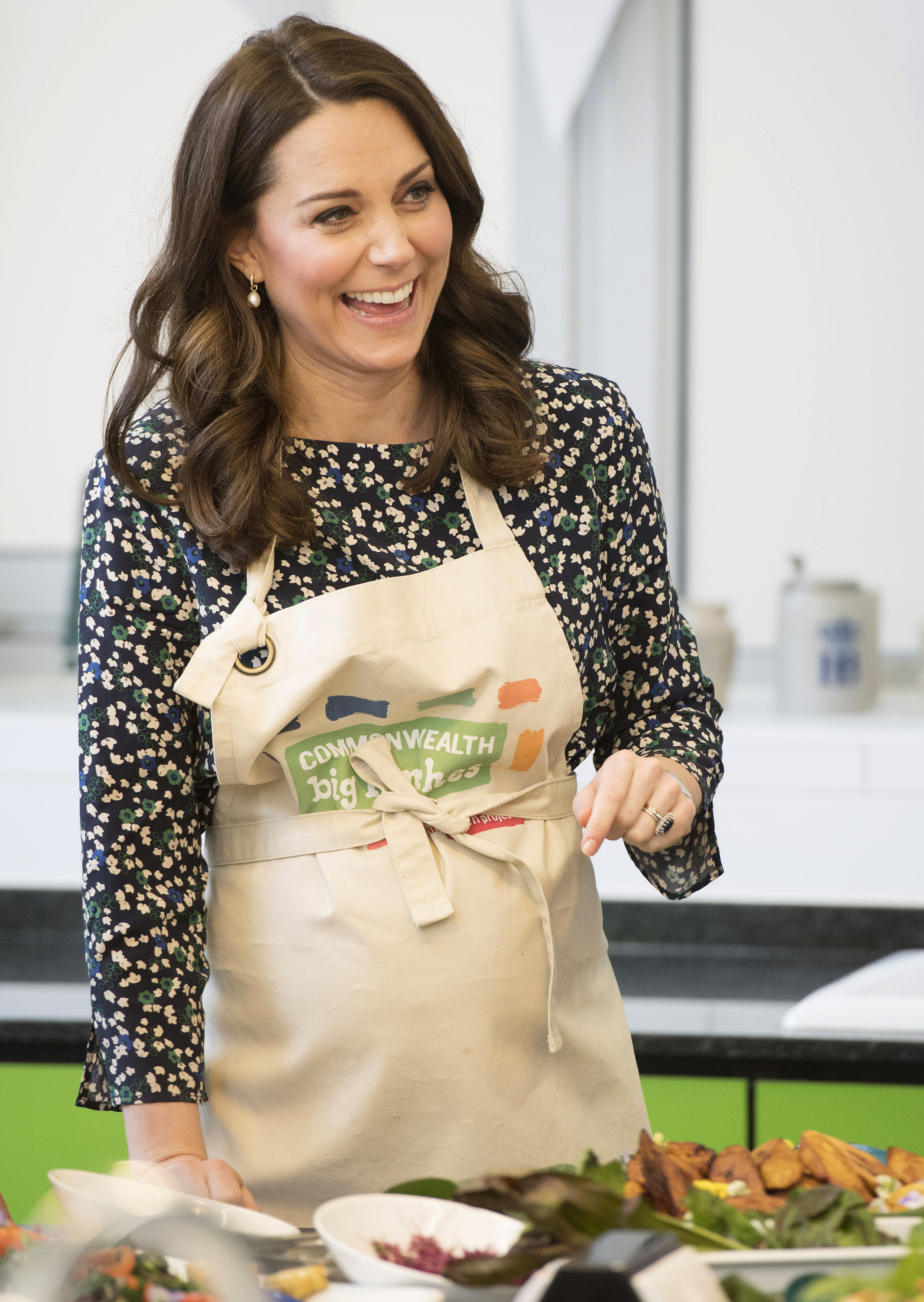 <div class='meta'><div class='origin-logo' data-origin='none'></div><span class='caption-text' data-credit='Paul Edwards/ Pool via AP'>Britain's Kate Duchess of Cambridge taking part in preparations for a Commonwealth Big Lunch at St Luke's Community Centre, London, Thursday March 22, 2018.</span></div>