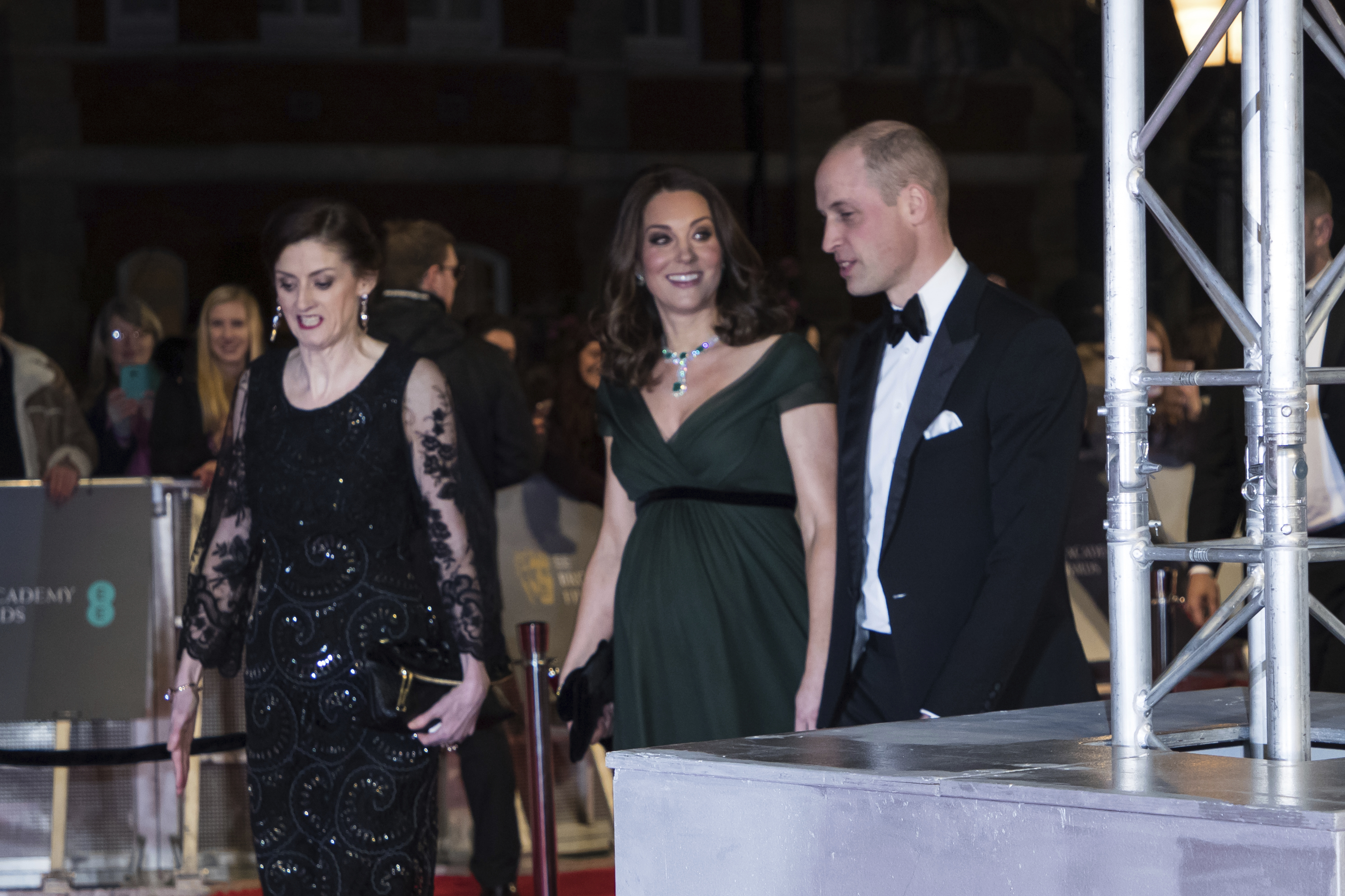 <div class='meta'><div class='origin-logo' data-origin='none'></div><span class='caption-text' data-credit='Vianney Le Caer/Invision/AP'>Britain's Kate, the Duchess of Cambridge and William, Duke of Cambridge arrive with Chief Executive of BAFTA Amanda Berry at the BAFTA Awards 2018 in London, Sunday, Feb. 18, 2018.</span></div>