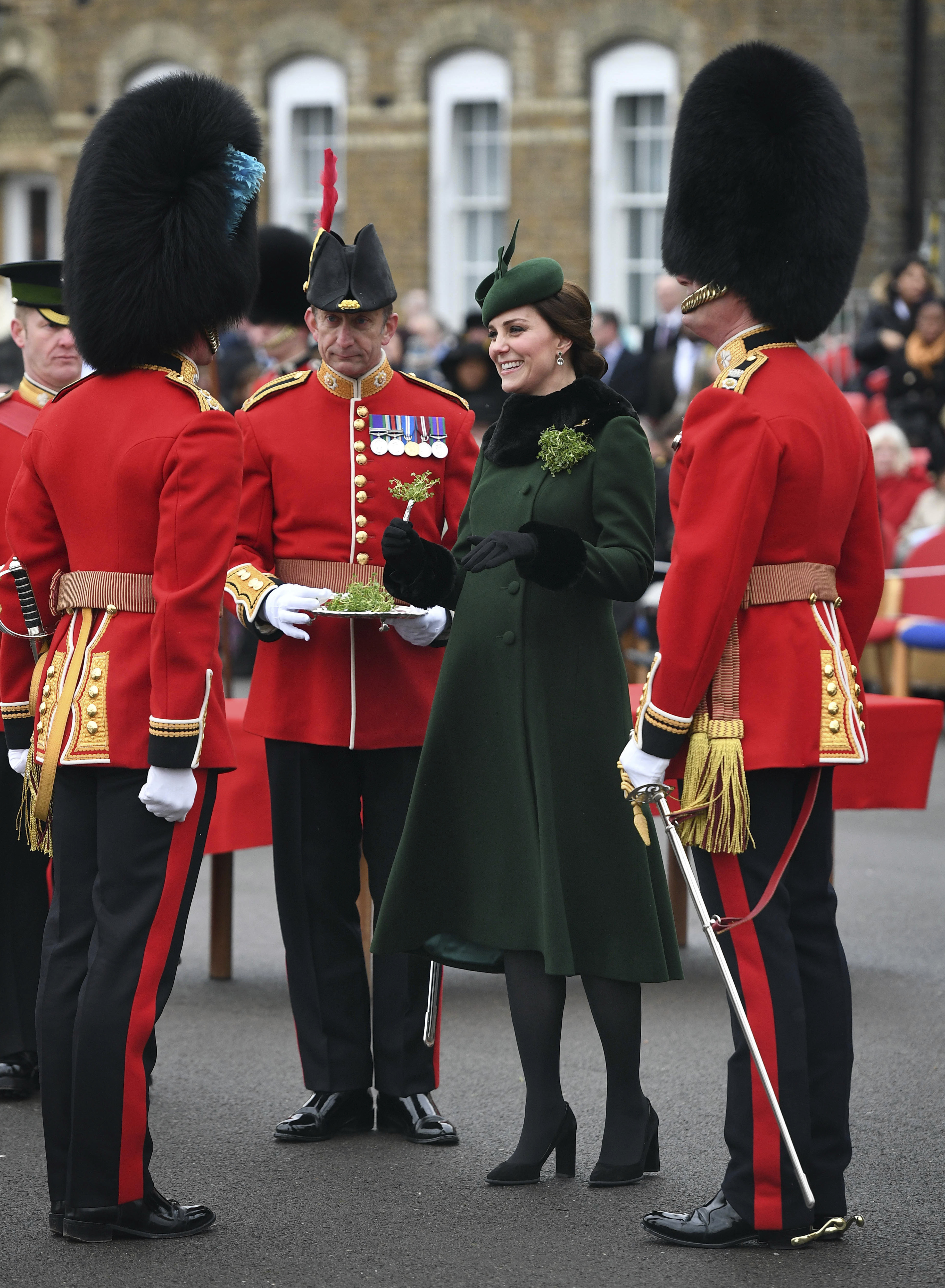 "<div class=""meta image-caption""><div class=""origin-logo origin-image none""><span>none</span></div><span class=""caption-text"">Britain's Kate, the Duchess of Cambridge, smiles as she visits the 1st Battalion Irish Guards, for the St. Patrick's Day Parade in Hounslow, England, March 17, 2018. (Andrew Parsons/Pool Photo via AP)</span></div>"