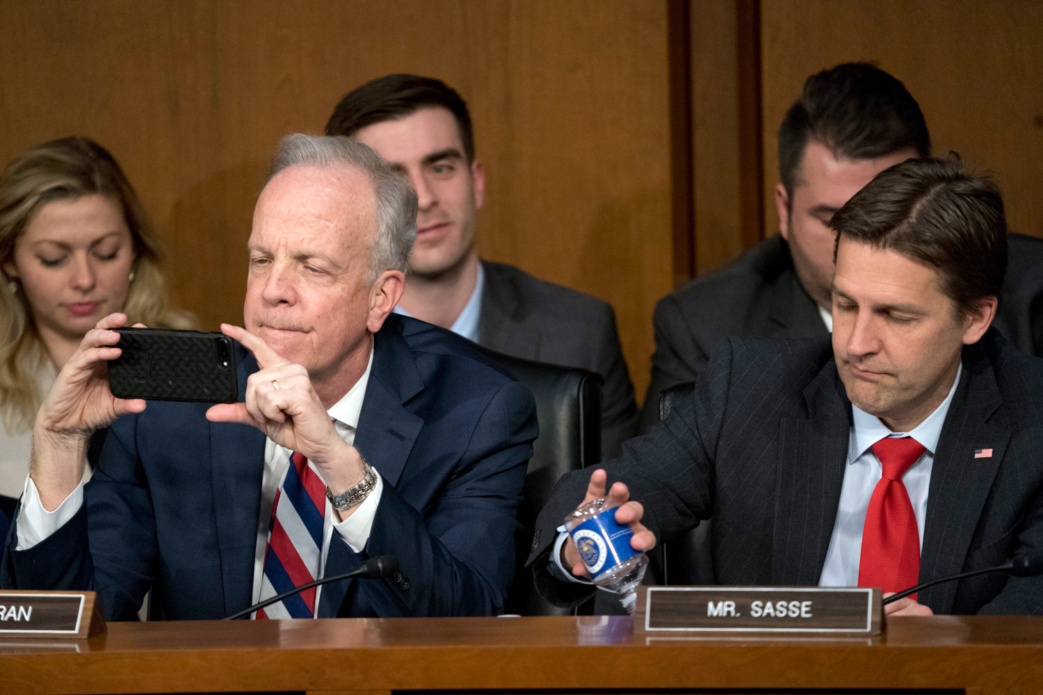 "<div class=""meta image-caption""><div class=""origin-logo origin-image none""><span>none</span></div><span class=""caption-text"">Sen. Jerry Moran, R-Kan., left, accompanied by Sen. Ben Sasse, R-Neb., right, takes a photo as Facebook CEO Mark Zuckerberg testifies. (Andrew Harnik/AP Photo)</span></div>"
