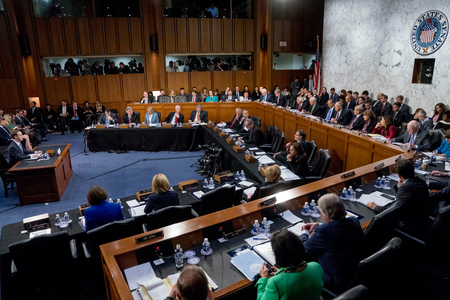 <div class='meta'><div class='origin-logo' data-origin='none'></div><span class='caption-text' data-credit='Andrew Harnik/AP Photo'>Facebook CEO Mark Zuckerberg, left, testifies before a joint hearing of the Commerce and Judiciary Committees on Capitol Hill in Washington, Tuesday.</span></div>