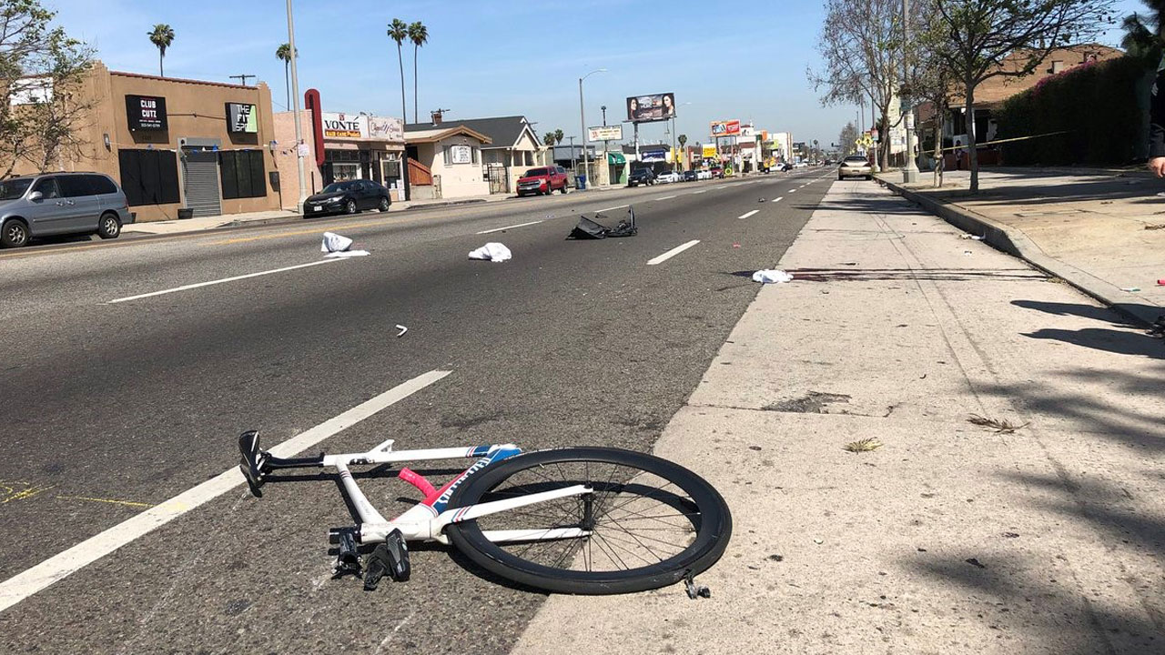 Pieces of a bicycle are strewn across a street after a fatal hit-and-run crash in South Los Angeles on Tuesday, April 10, 2018.