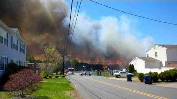 """<div class=""""meta image-caption""""><div class=""""origin-logo origin-image """"><span></span></div><span class=""""caption-text"""">Viewer photo from  a massive brush fire in Beachwood, New Jersey on April 24, 2014</span></div>"""