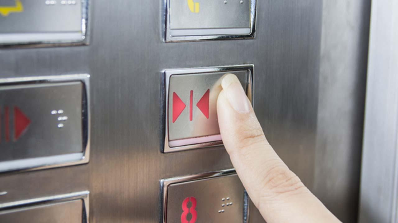 Elevator door close button