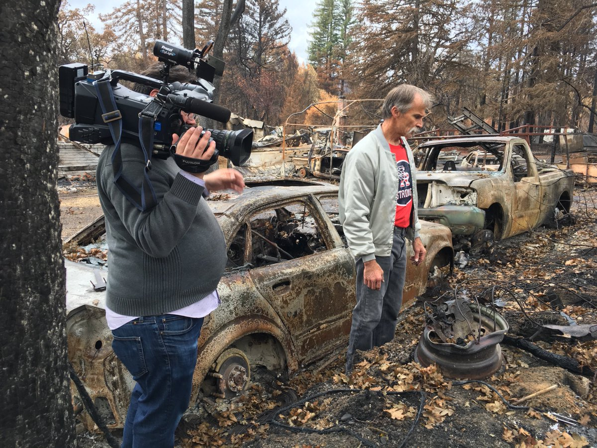Neil Blodgett looks through what was left of his home after the North Bay fires in Santa Rosa, Calif.