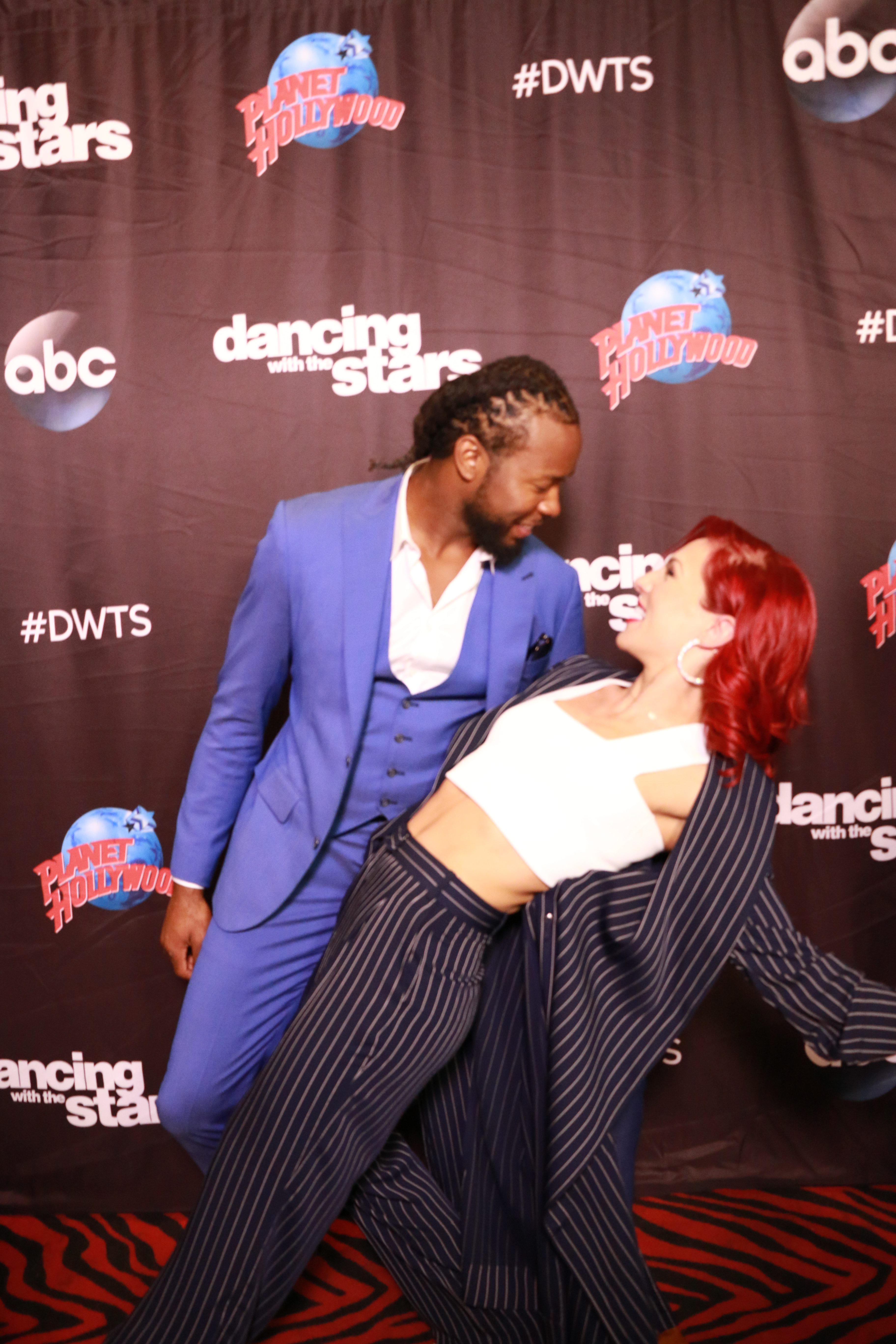 <div class='meta'><div class='origin-logo' data-origin='none'></div><span class='caption-text' data-credit='Heather Harkins/WABC'>Josh Norman with Sharna Burgess on the red carpet of the ''Dancing with the Stars'' cast announcement on ''Good Morning America.''</span></div>