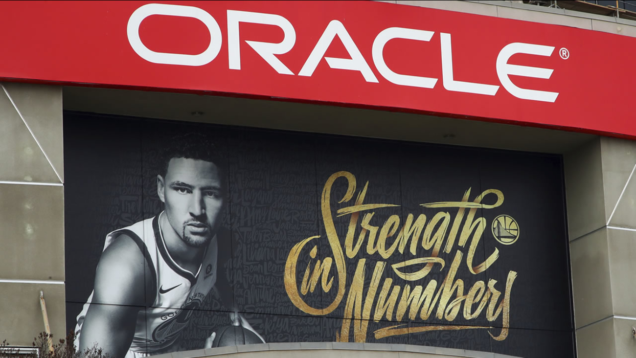 A banner depicting Golden State Warriors' Klay Thompson hangs on the exterior of Oracle Arena, Tuesday, April 10, 2018, in Oakland, Calif. (AP Photo/Ben Margot)