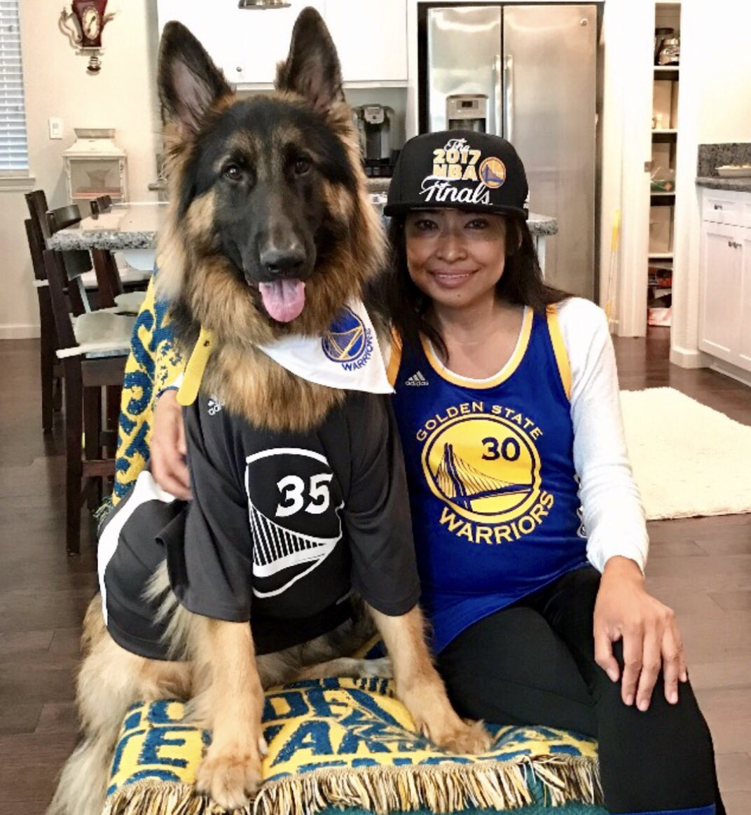 <div class='meta'><div class='origin-logo' data-origin='none'></div><span class='caption-text' data-credit='@eleanoraguila/Twitter'>Eleanor Aguila is seen wearing her Warriors gear next to her dog ahead of Game 1 of the NBA Playoffs against the Spurs on Saturday, April 14, 2018.</span></div>