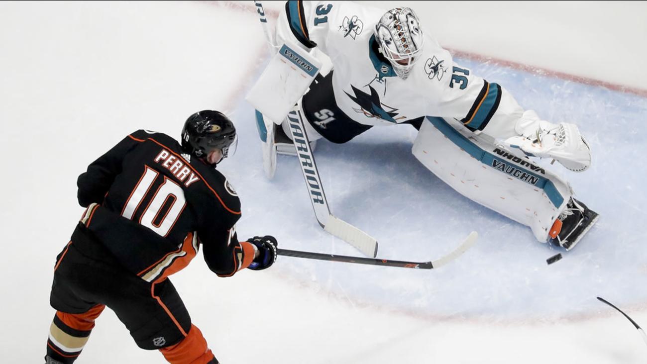 San Jose Sharks goaltender Martin Jones blocks a shot by Anaheim Ducks' Corey Perry in an NHL hockey first-round playoff series in Anaheim, Calif., Saturday, April 14, 2018.