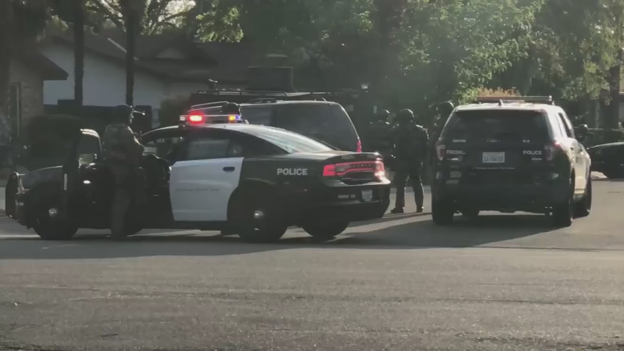 SWAT and Fresno Police block road as they search Northwest Fresno home