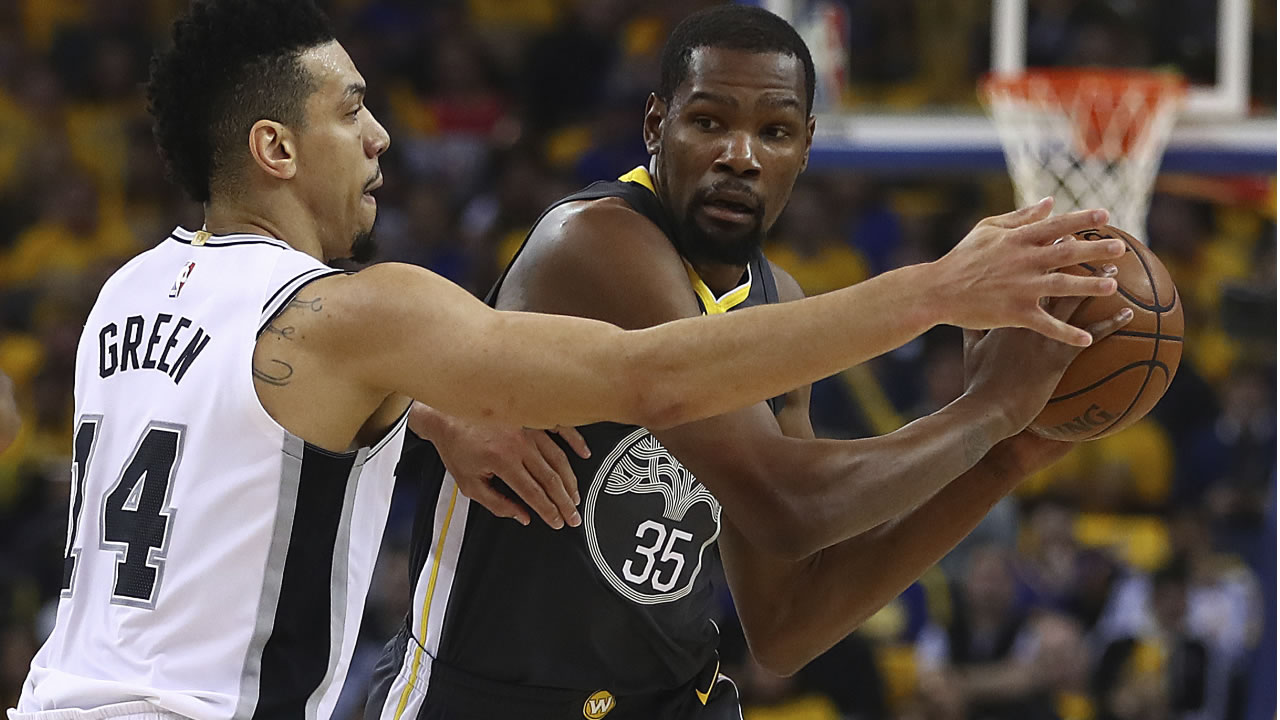 Warriors' Kevin Durant is guarded by Spurs' Danny Green during Game 2 of a first-round NBA basketball playoff series Monday, April 16, 2018, in Oakland, Calif. (AP Photo)