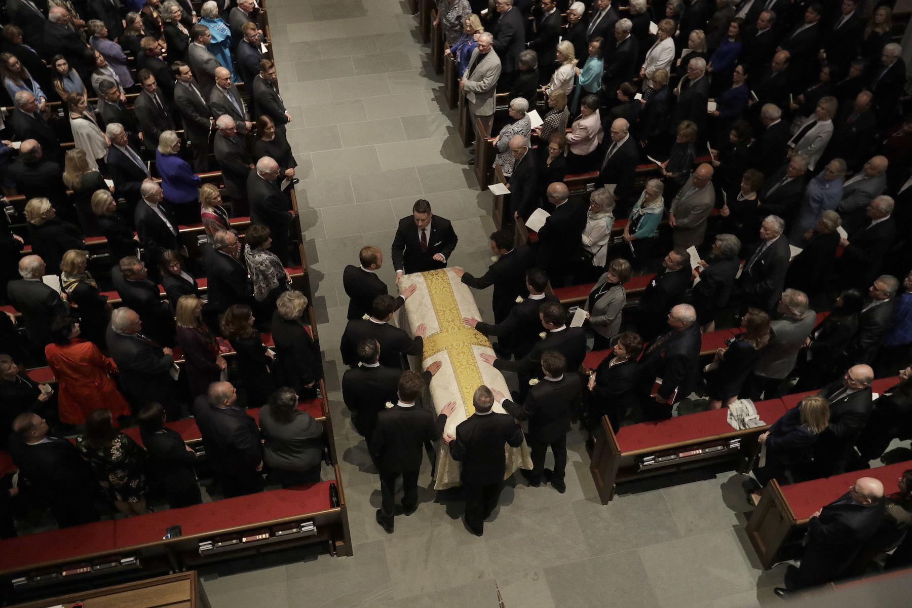 <div class='meta'><div class='origin-logo' data-origin='AP'></div><span class='caption-text' data-credit='AP Photo/David J. Phillip'>Grandson pallbearers prepare the casket of former first lady Barbara Bush during the funeral service at St. Martin's Episcopal Church, Saturday, April 21, 2018, in Houston.</span></div>