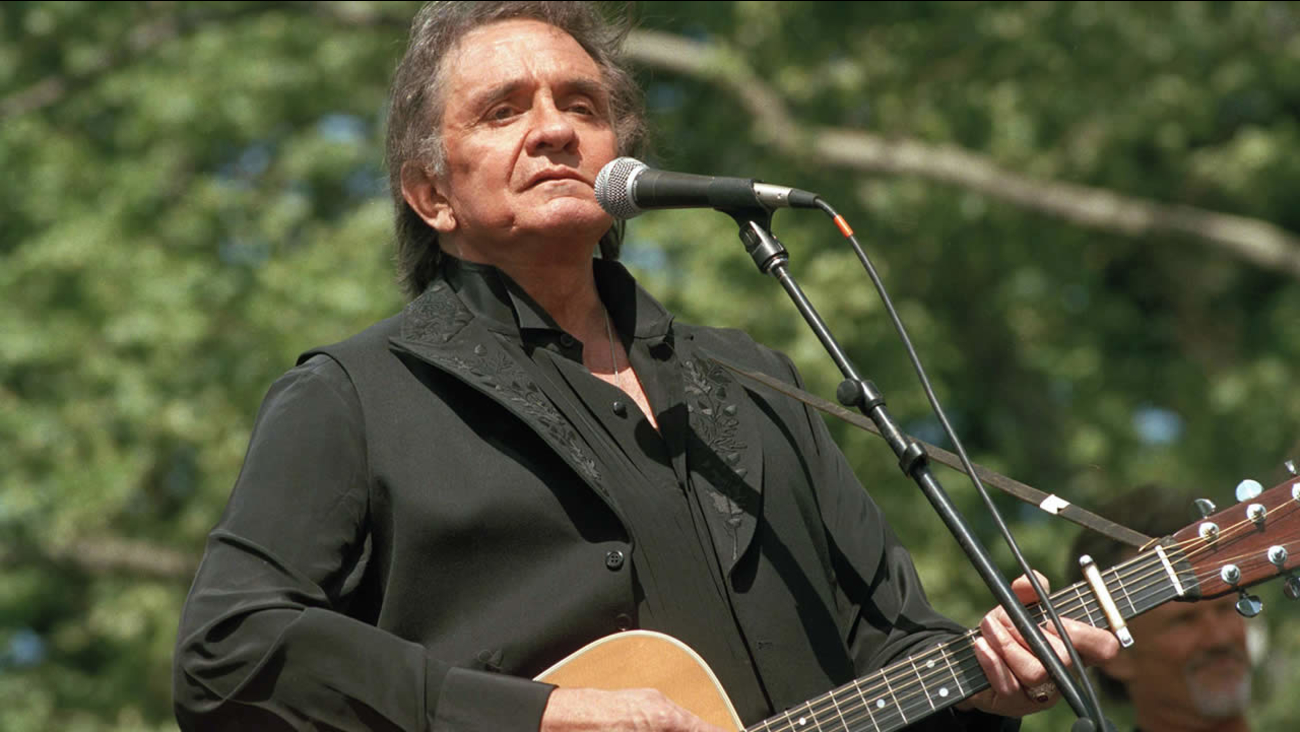 In this May 23, 1993 file photo, Johnny Cash performs at a benefit concert in Central Park in New York. (AP Photo/Joe Tabacca, File)