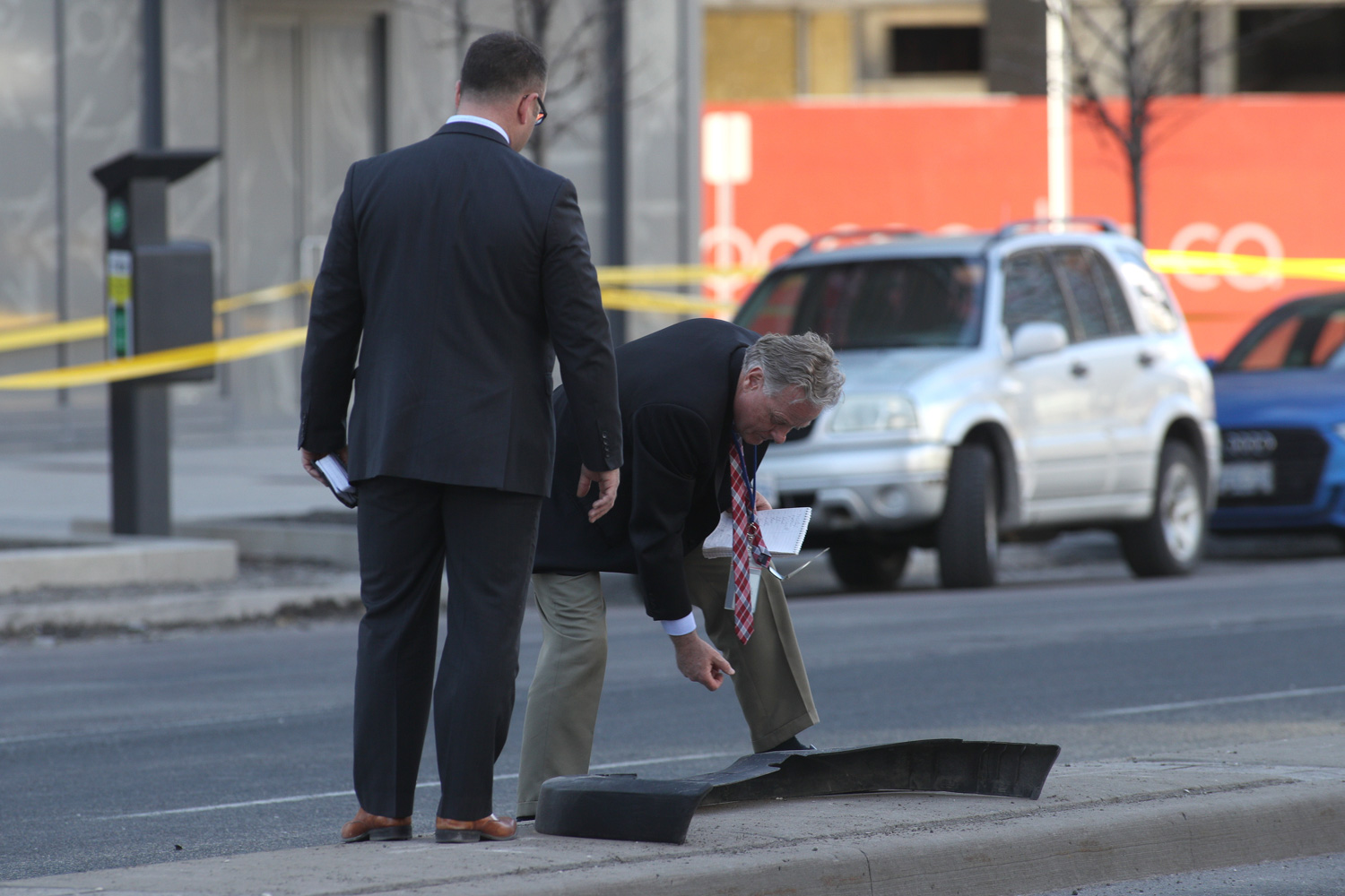 """<div class=""""meta image-caption""""><div class=""""origin-logo origin-image none""""><span>none</span></div><span class=""""caption-text"""">Forensic police officers look a car bumper after a truck drove up on the curb and hit several pedestrians in Toronto, Ontario, on April 23, 2018. (Lars Hagberg/AFP/Getty Images)</span></div>"""