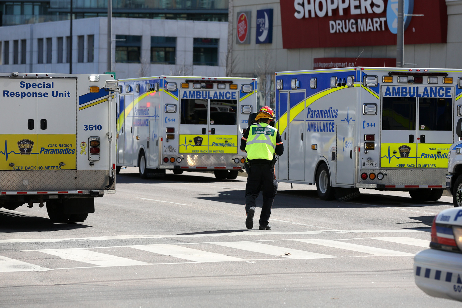 """<div class=""""meta image-caption""""><div class=""""origin-logo origin-image none""""><span>none</span></div><span class=""""caption-text"""">Police officers stand near several ambulances after a truck hit several pedestrians in Toronto, Ontario, on on April 23, 2018. (Lars Hagberg/AFP/Getty Images)</span></div>"""