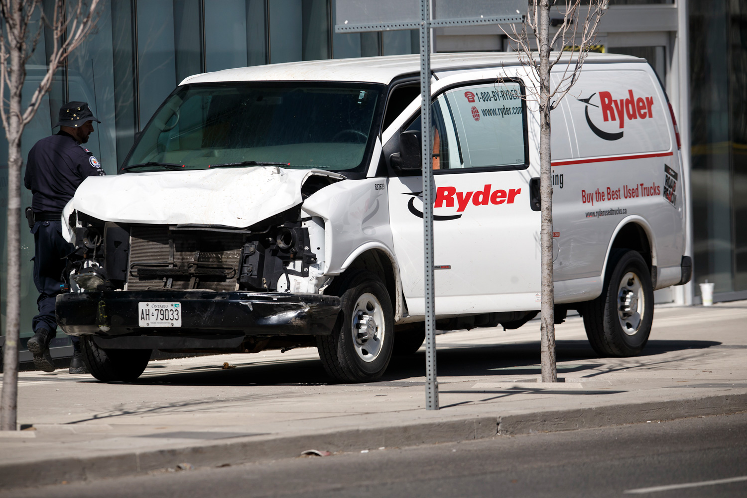 """<div class=""""meta image-caption""""><div class=""""origin-logo origin-image none""""><span>none</span></div><span class=""""caption-text"""">Police inspect a van suspected of being involved in a collision injuring at least eight people at Yonge St. and Finch Ave. on April 23, 2018 in Toronto, Canada (Cole Burston/Getty Images)</span></div>"""