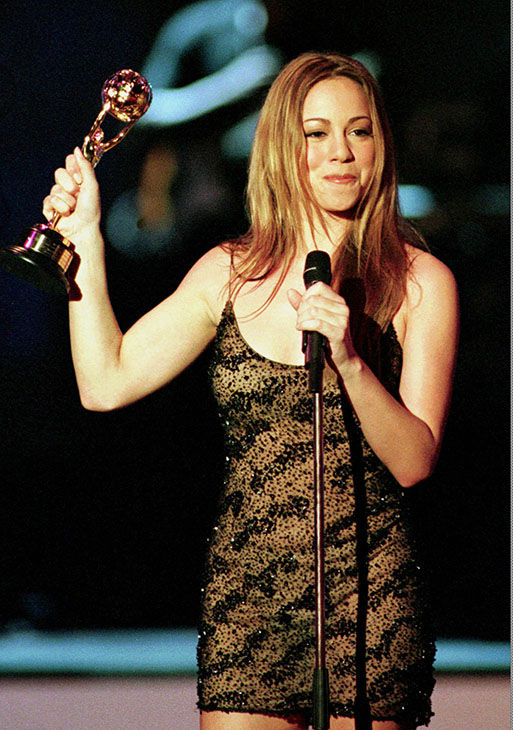 <div class='meta'><div class='origin-logo' data-origin='none'></div><span class='caption-text' data-credit='AP'>Singer Mariah Carey holds the World's Best-Selling Artist of the 90s award, during the 10th World Music Awards, Wednesday May 6, 1998.</span></div>