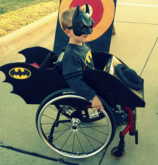 "<div class=""meta image-caption""><div class=""origin-logo origin-image ""><span></span></div><span class=""caption-text"">Halloween 2011 with Caleb, 6, as Batman in his batmobile. (Photo/Cassie McLelland)</span></div>"