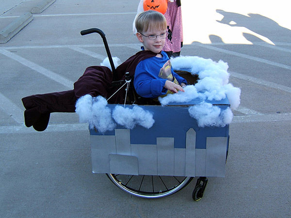 "<div class=""meta image-caption""><div class=""origin-logo origin-image ""><span></span></div><span class=""caption-text"">Halloween 2009 with Caleb, 4, as Superman flying through the clouds. (Cassie McLelland)</span></div>"