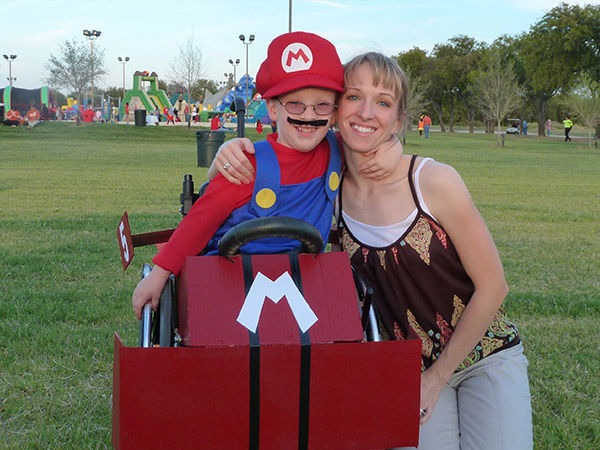 "<div class=""meta image-caption""><div class=""origin-logo origin-image ""><span></span></div><span class=""caption-text"">Caleb with his mother Cassie, who helps make all his costumes. (Glenn McLelland)</span></div>"
