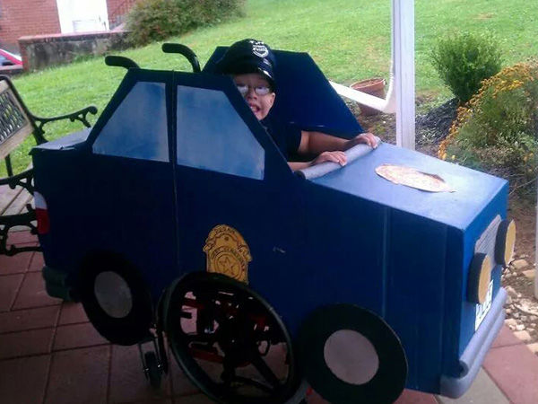 "<div class=""meta image-caption""><div class=""origin-logo origin-image ""><span></span></div><span class=""caption-text"">Brenden, 6, as a police officer driving his vehicle. (Michelle Dugan)</span></div>"