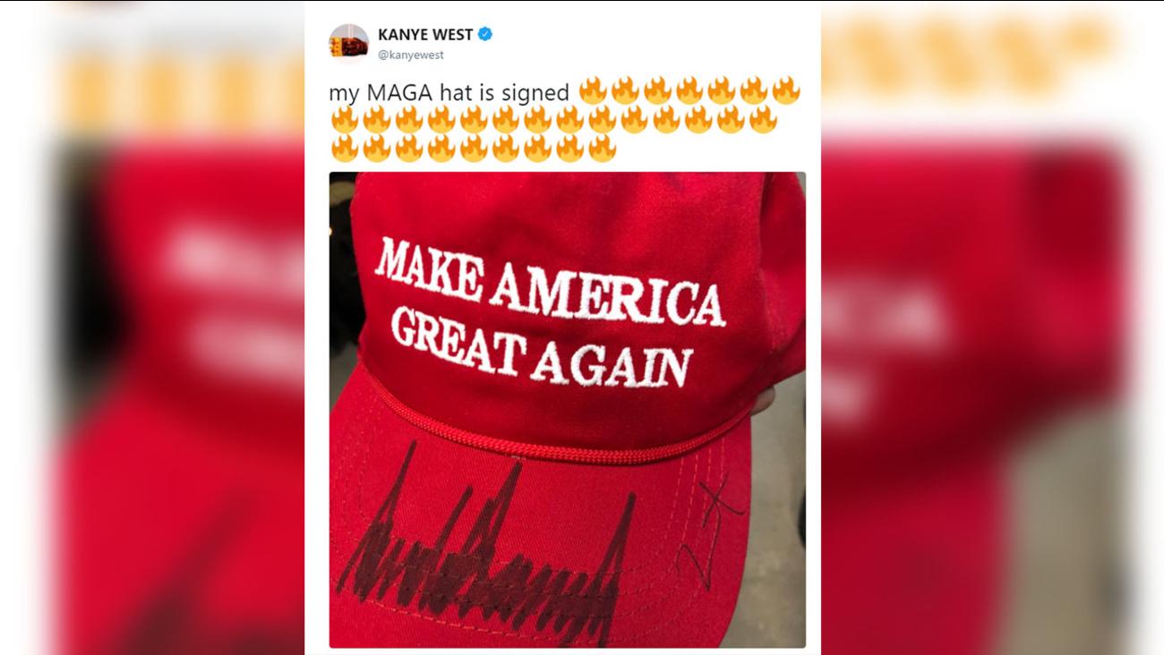 Trumps signs Kanye's MAGA hat