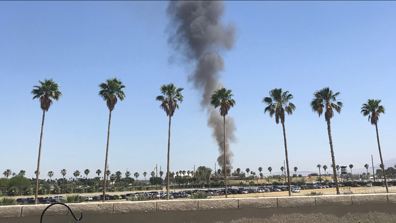 Smoke from an RV fire is seen from the Stagecoach Festival in Indio.