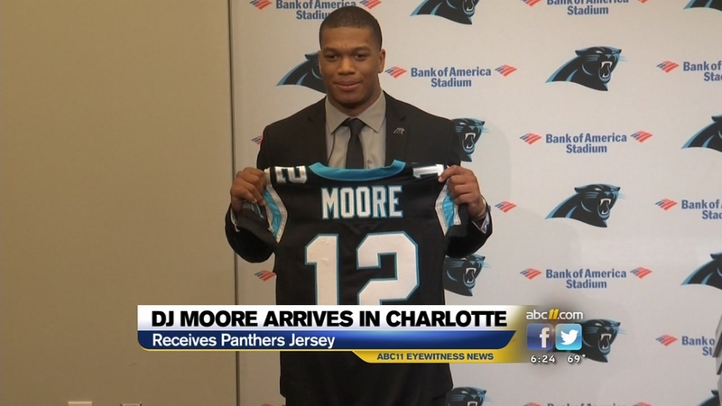 buy online 30a0e 399bf First-round pick D.J. Moore arrived in Charlotte on Friday ...