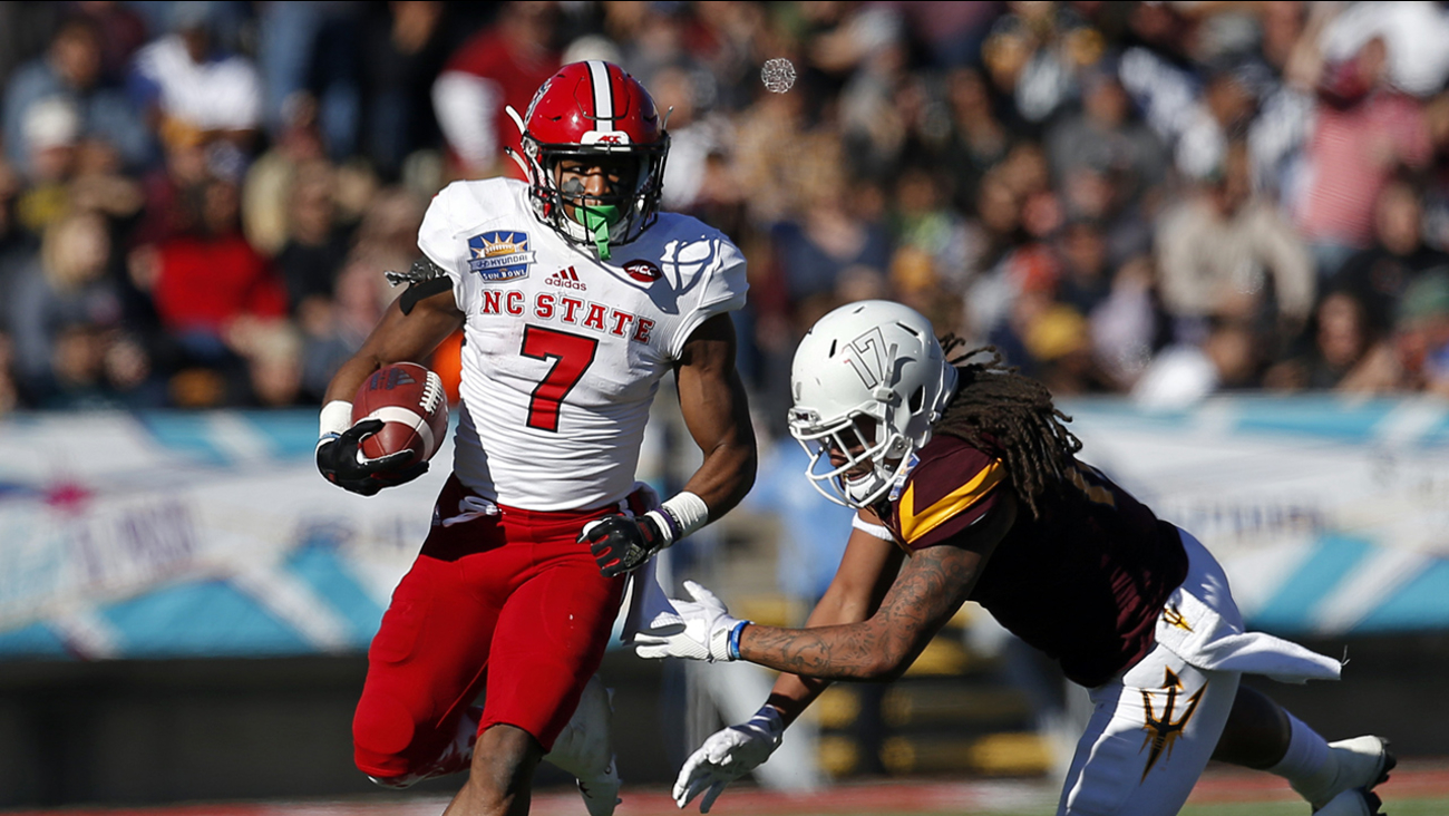 N.C. State's Nyheim Hines runs away from an Arizona State defender in the Sun Bowl.