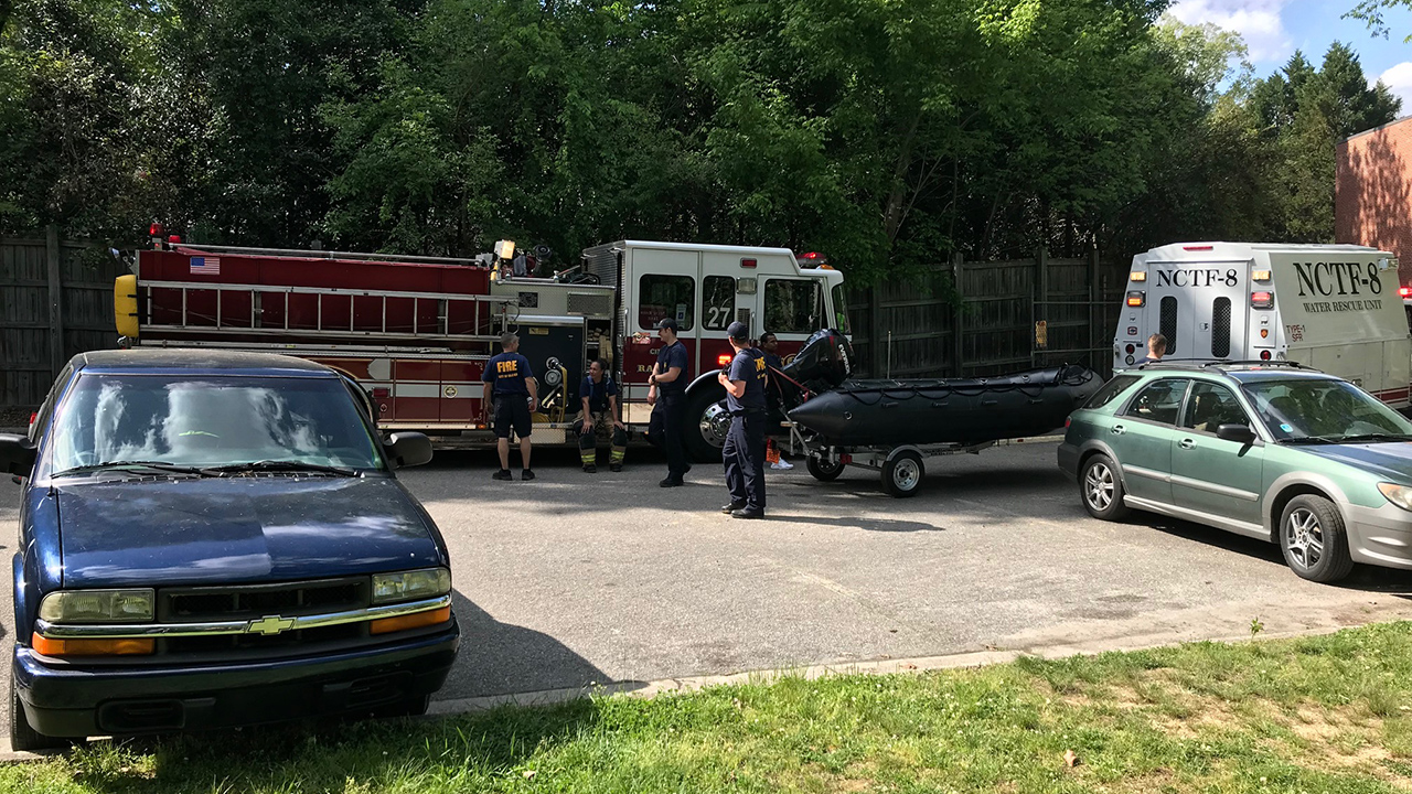 Rescuers pulled three people out of the Neuse River after a canoe tipped over Saturday.