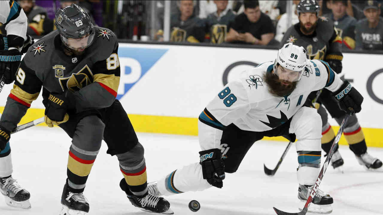 Sharks player Brent Burns (88) and Golden Knights player Alex Tuch (89) vie for the puck during Game 2 of an NHL second-round playoff series Saturday, April 28, 2018, in Las Vegas.