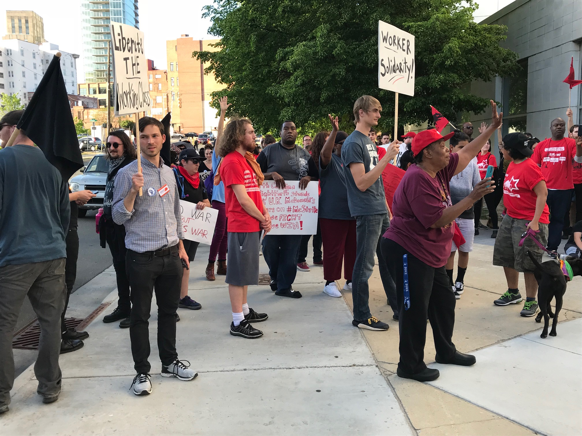 "<div class=""meta image-caption""><div class=""origin-logo origin-image wtvd""><span>WTVD</span></div><span class=""caption-text"">The Durham Workers Assembly and other protesters marched in downtown Durham on May Day to demand higher wages, union rights, an end to ICE raids and evictions. (Robert Judson)</span></div>"
