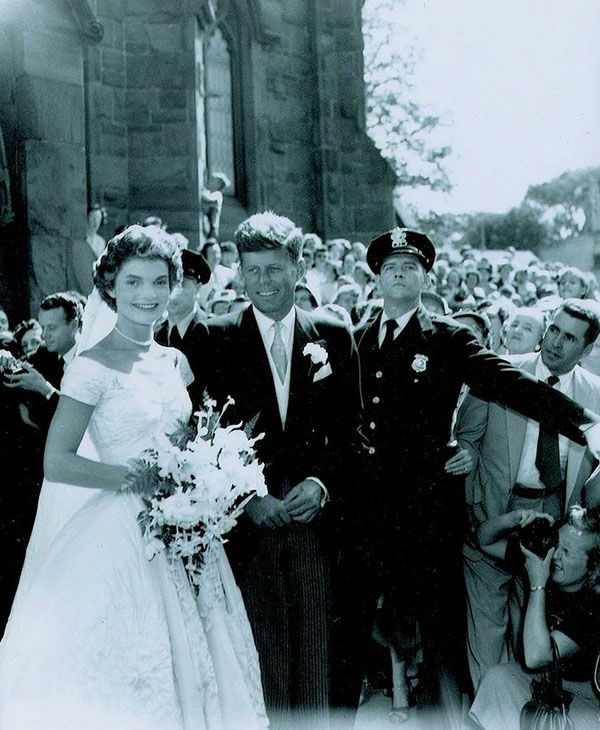 "<div class=""meta image-caption""><div class=""origin-logo origin-image ""><span></span></div><span class=""caption-text"">John and Jacqueline Kennedy on their wedding day on September 12, 1953. (RR Auction)</span></div>"