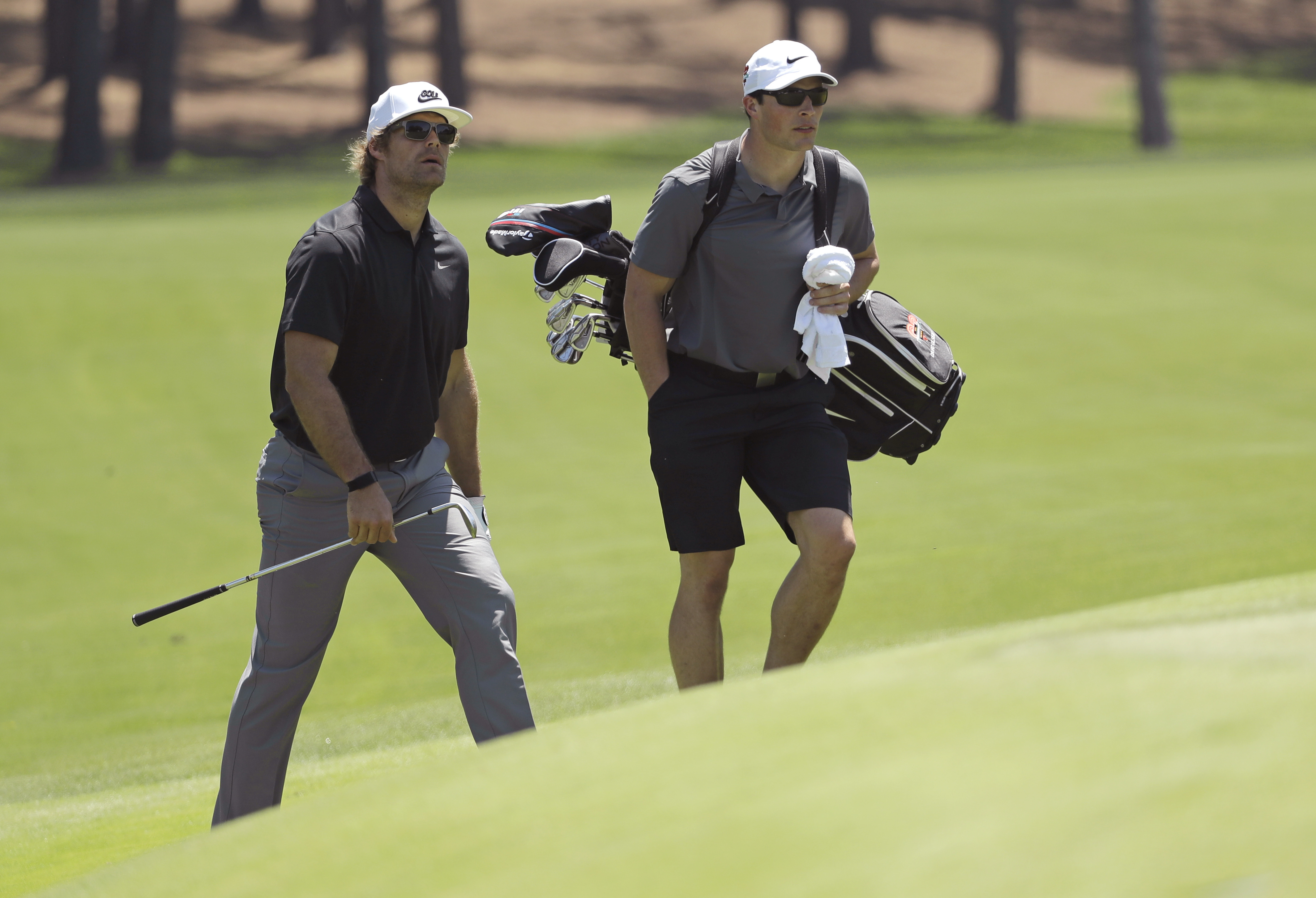 "<div class=""meta image-caption""><div class=""origin-logo origin-image ap""><span>AP</span></div><span class=""caption-text"">Carolina Panthers' Greg Olsen, left, and his caddie, Carolina Panthers' Luke Kuechly, right, walk to the second green during the pro-am. (Chuck Burton)</span></div>"